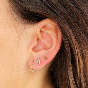 Piercing en oro Triangulo circonitas
